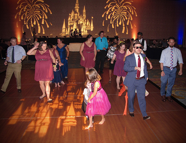 Wedding guests dance and have fun at one of Orlando DJ Chuck Johnson's gay weddings.