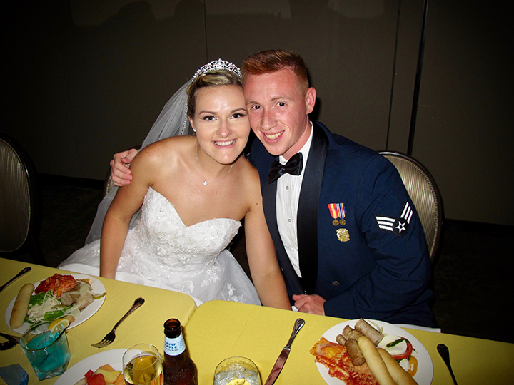 The bride and groom pose for a pic at the their Sweetheart table, during the reception hosted by Orlando DJ Chuck Johnson.