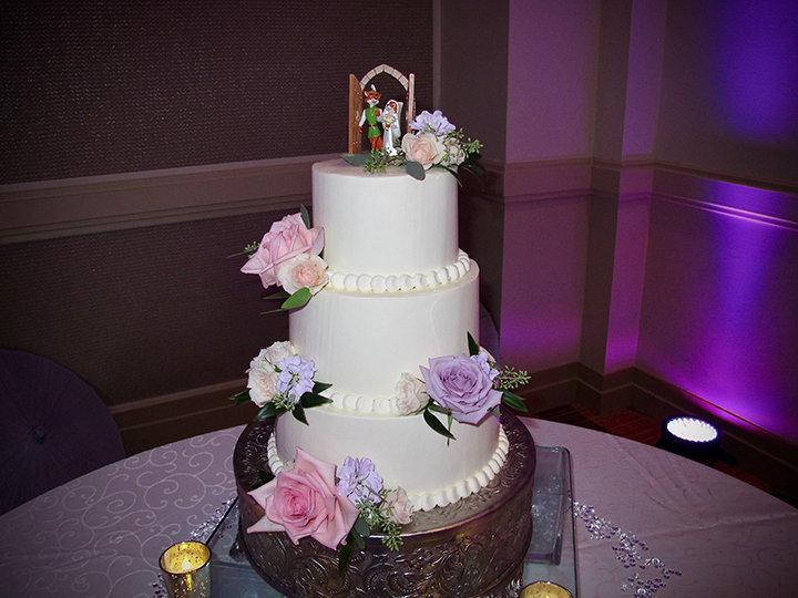 Robin Hood sits atop this Disney inspired wedding cake at the Swan Hotel.