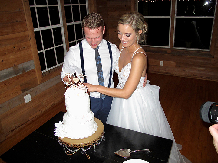 Orlando Wedding DJ Chuck Johnson helps the couple cut the cake at their reception