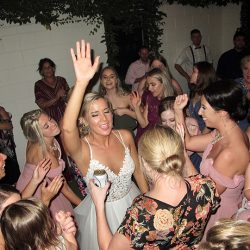 The bride celebrates with family and friends at her wedding at the Acre Orlando with DJ Chuck Johnson