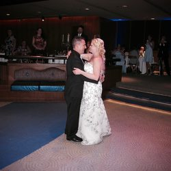 A bride and groom share their First Dance together at a Walt Disney World Wedding with Orlando DJ Chuck Johnson.