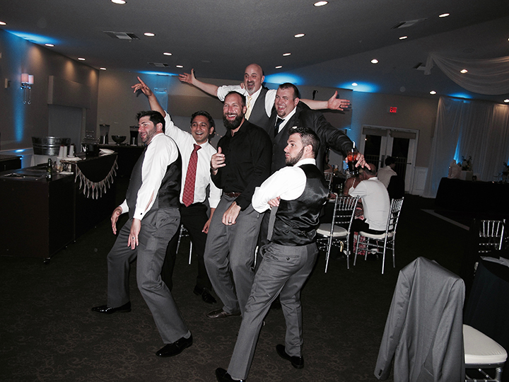 The groom and his buddies have some fun at a Royal Crest Room Wedding with Orlando DJ Chuck Johnson.