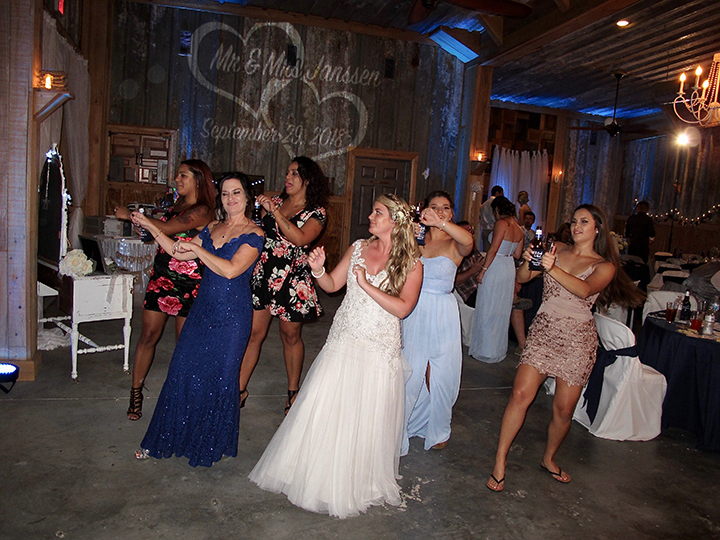 The bride and her friends take to the dance floor with Tampa Wedding DJ Chuck Johnson.