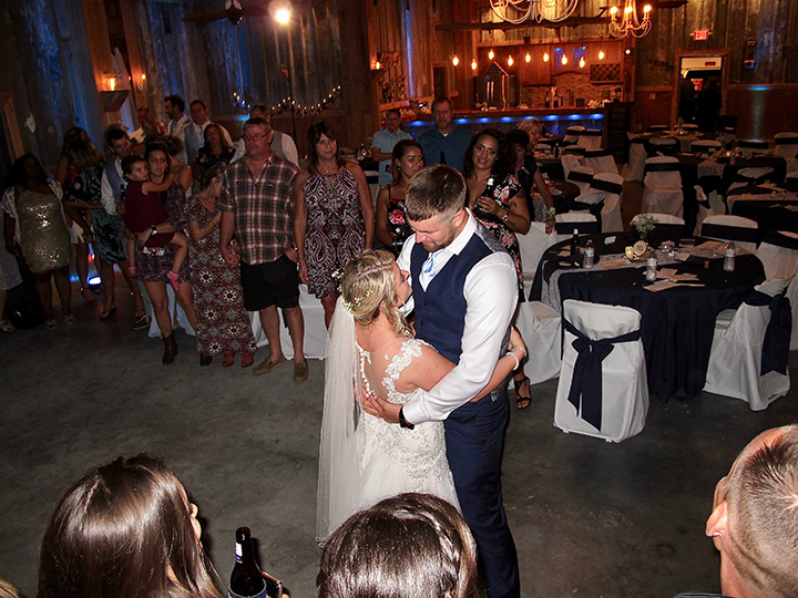 The wedding couple share the last dance with their guests and Tampa DJ Chuck Johnson.