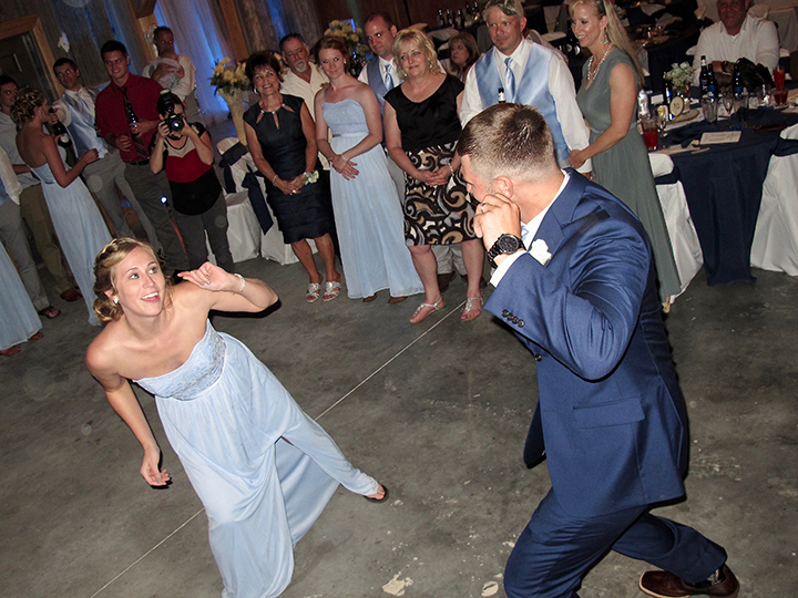 The groom dances with family and friends at the Venue By The Lake in Thonotosassa FL.