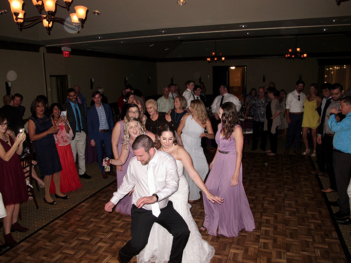 Bride and Groom having the time of their life on the Dance Floor with Orlando Wedding DJ Chuck Johnson