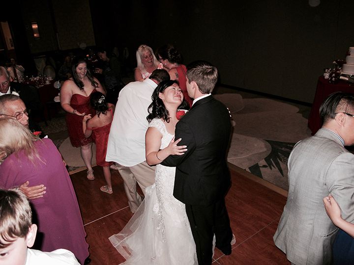 The couple share the dance floor during their wedding reception at Shades of Green at WDW.