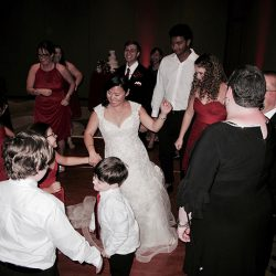 The bride is on the dance floor celebrating her reception with Orlando Wedding DJ Chuck at Shades of Green