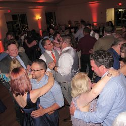Same-sex wedding couple Wes and Derek celebrate with their guests and Orlando DJ Chuck Johnson