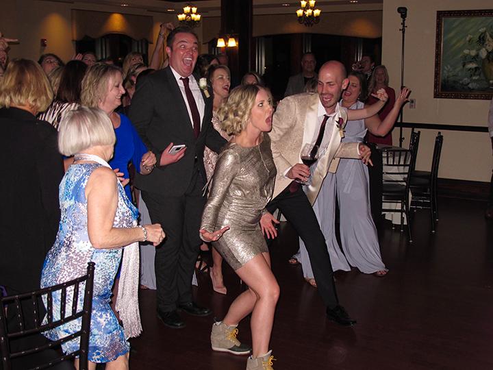 Guests enjoying the wedding reception at the Tavares Pavilion on the Lake with Orlando DJ Chuck Johnson.