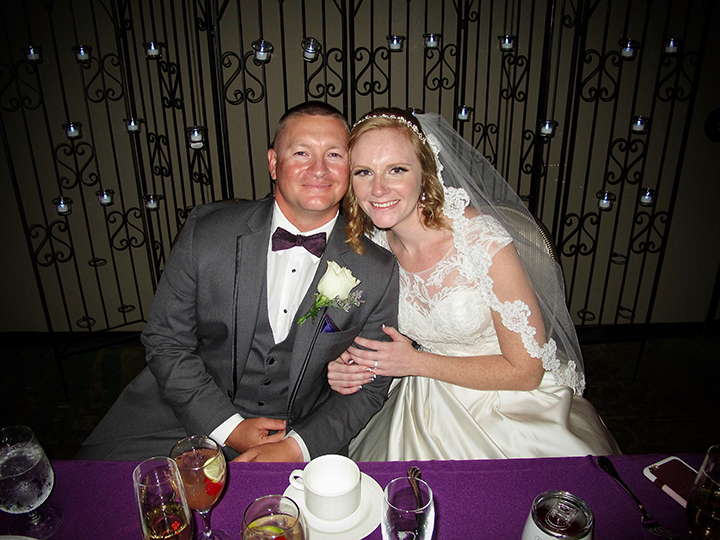 The Bride and Groom at their Sweetheart table during a Shades of Green Wedding Reception.