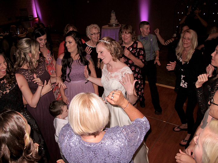 The bride having fun on the dance floor with Orlando Wedding DJ Chuck Johnson.