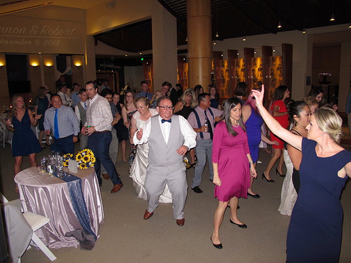 The bride and groom having fun at their wedding at St Augustine's World Golf Hall of Fame.