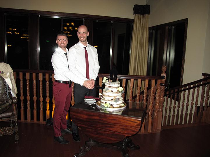Same-sex wedding couple DJ and Jake celebrating their wedding at the Tavares Pavilion on the Lake.