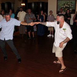 Having fun on the dance floor with orlando wedding dj chuck at the tavares pavilion on the lake