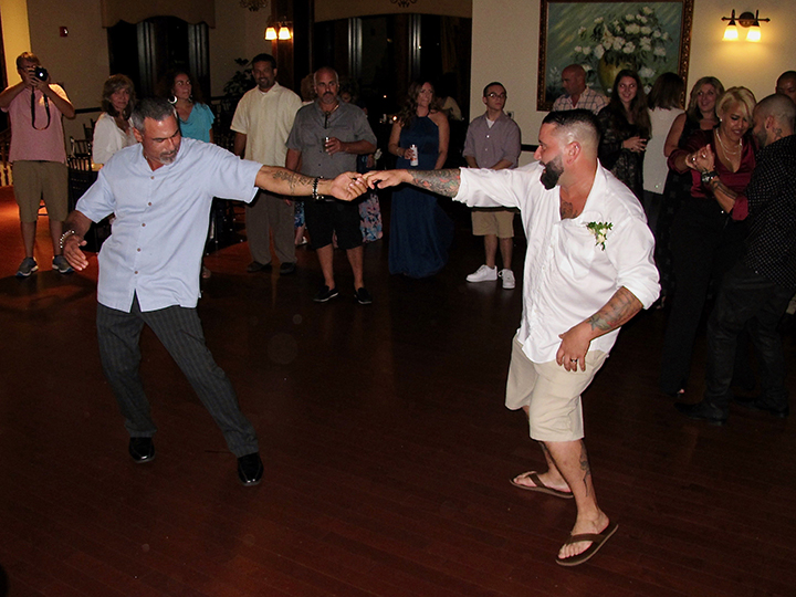 Having fun on the dance floor with orlando wedding dj chuck at the tavares pavilion on the lake.