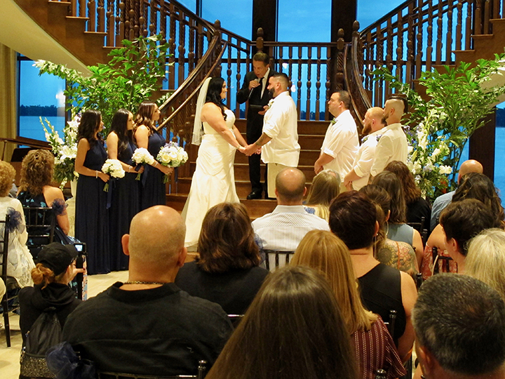 An inside wedding ceremony at the Tavares pavilion on the lake.