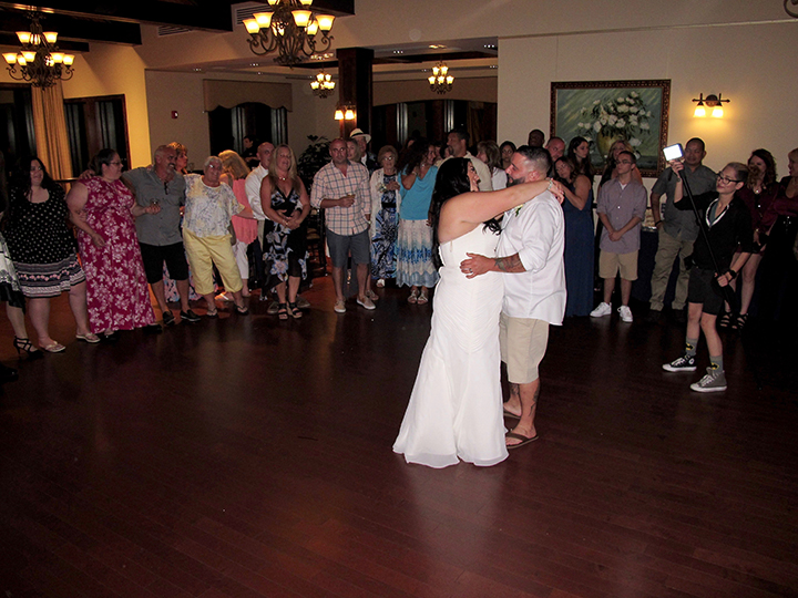 a couple sharing the dance floor at their wedding reception with orlando wedding dj chuck johnson