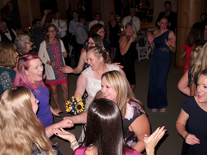 Having fun with family and friends on the dance floor with St Augustine wedding DJ Chuck Johnson