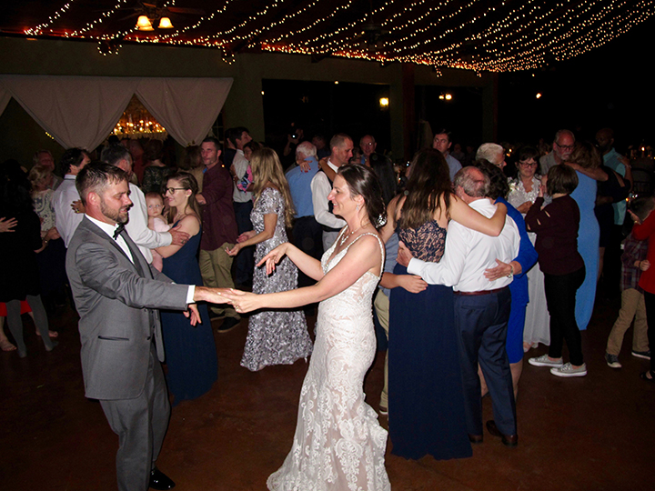 The Bride and Groom dance with their guests at the Sunset Ranch Wedding Venue.