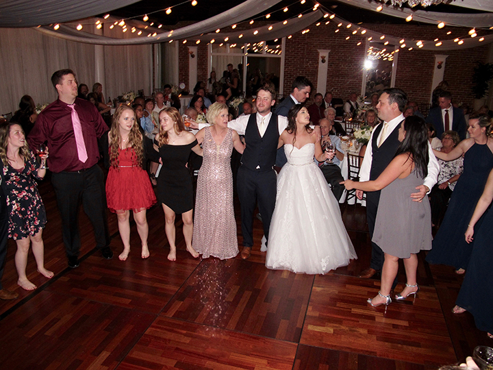 Family and friends celebrate with St Augustine Wedding DJ Chuck Johnson at the White Room.