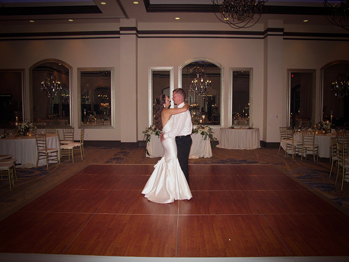A Bride and Groom sharing the Last Dance of the Reception with Orlando Wedding DJ Chuck Johnson.