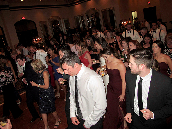 Having a great time on the dance floor at a Wyndham Grand Bonnet Creek Wedding.