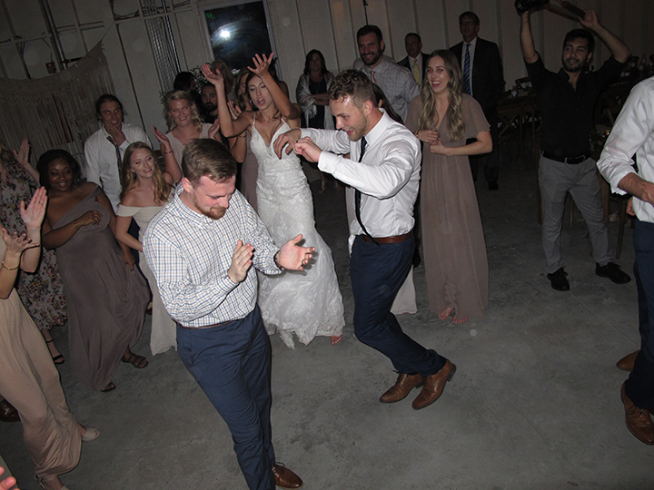 The bride and groom and wedding guests have fun on the dance floor with Orlando DJ Chuck Johnson.