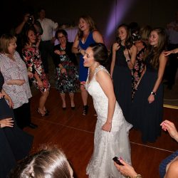 A bride with her wedding guests having fun with Orlando Wedding DJ Chuck Johnson