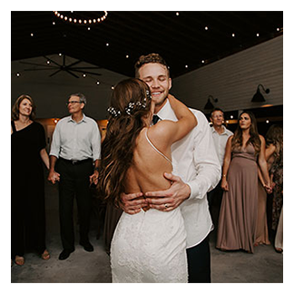 A couple enjoy their first dance as husband and wife with Orlando Wedding DJ Chuck Johnson.