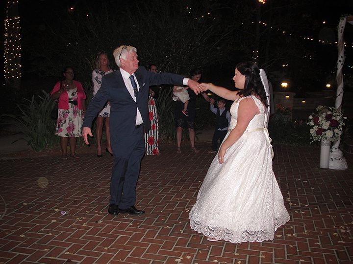 The bride dances with her dad at the Courtyard at Lake Lucerne Wedding Venue