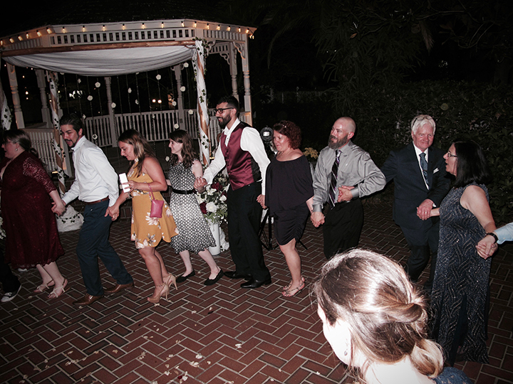 Friends and family dance the night away at the Courtyard at Lake Lucerne Wedding Venue