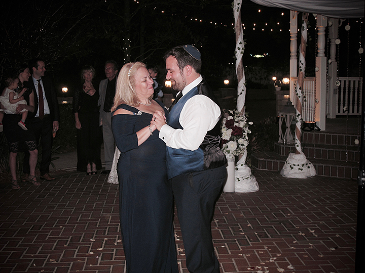 The groom and his mom share a dance at his wedding with Orlando Wedding DJ Chuck Johnson