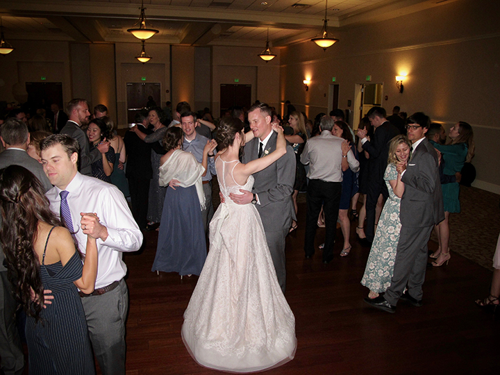 Friends and family having a great time on the dance floor with Orlando Wedding DJ Chuck Johnson