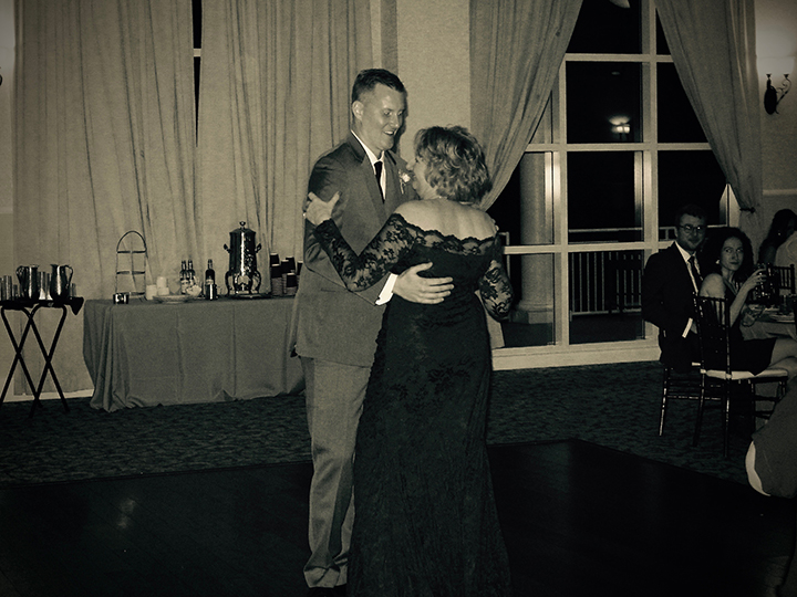 The groom dances with his mom at his wedding at the Lake Mary Events Center