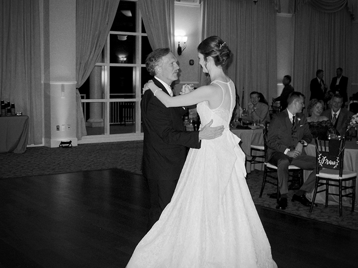 The bride dances with her dad at her wedding at the Lake Mary Events Center