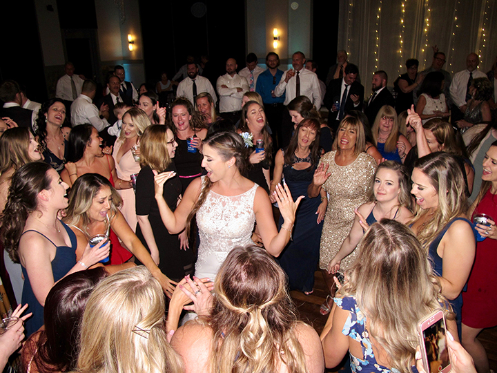 The bride and her friends take to the dance floor with Orlando DJ Chuck at NOAH's Event Venue.