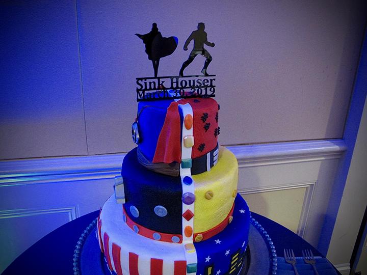 A Leu Gardens Marvel themed same-sex wedding cake on display.