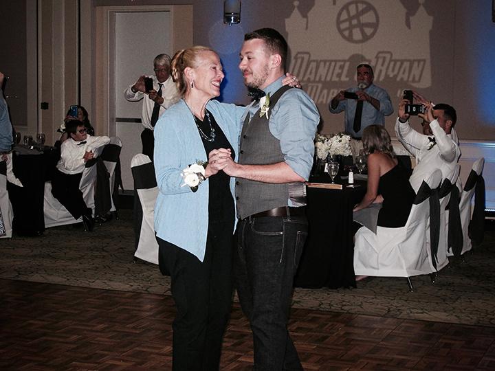 The Mom and Groom dance was a part of this Orlando Leu Gardens same-sex wedding.