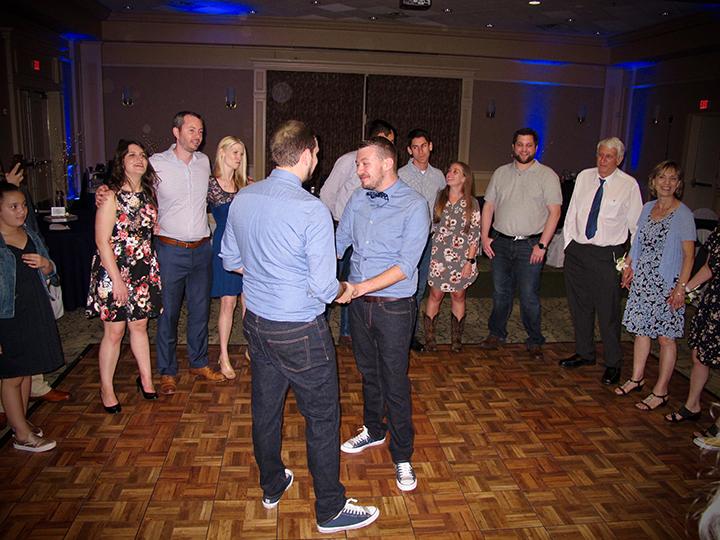 Friends and family celebrate a Leu Gardens same-sex wedding couple in Orlando.