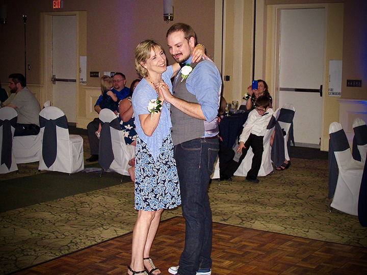 The groom dances with his mother at the celebration of his same-sex wedding at Leu Gardens.