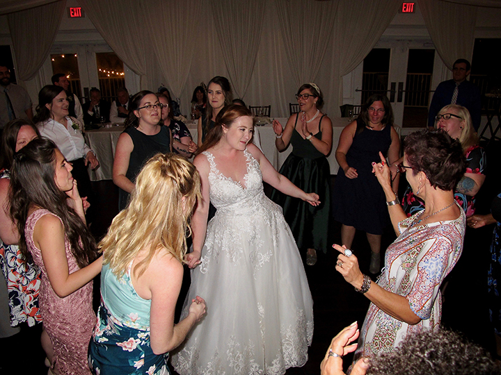 The Bride and her guests dance with Orlando DJ Chuck at the Royal Crest Room.