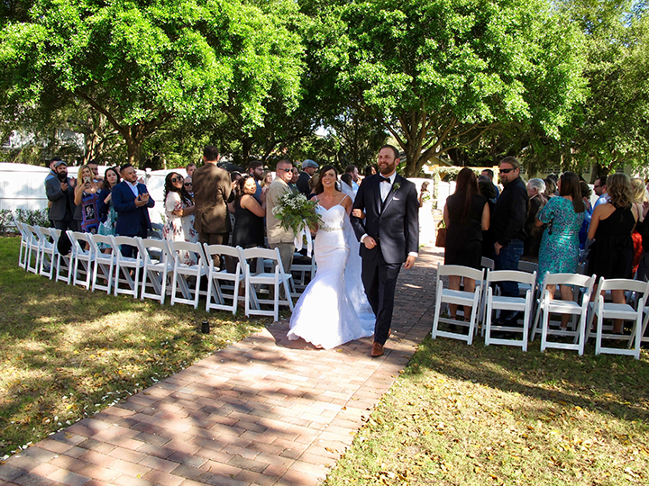"The wedding couple say ""I do"" at Sanford Wedding Venue 1902 in Central Florida."