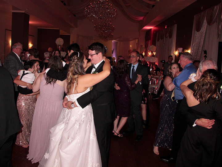 The wedding couple celebrate with Orlando Wedding DJ Chuck Johnson in MetroWest.