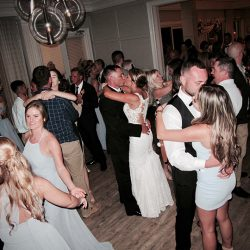 the wedding couple share the dance floor with friends and family during their reception.