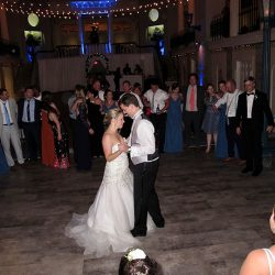 The Bride and Groom celebrate with Wedding DJ Chuck Johnson at the their reception at the Lightner Museum in St Augustine, FL.