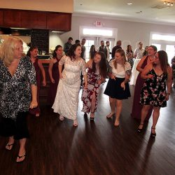 The Bride and her friends gather on the dance floor for her wedding at the Tuscawilla Country Club.