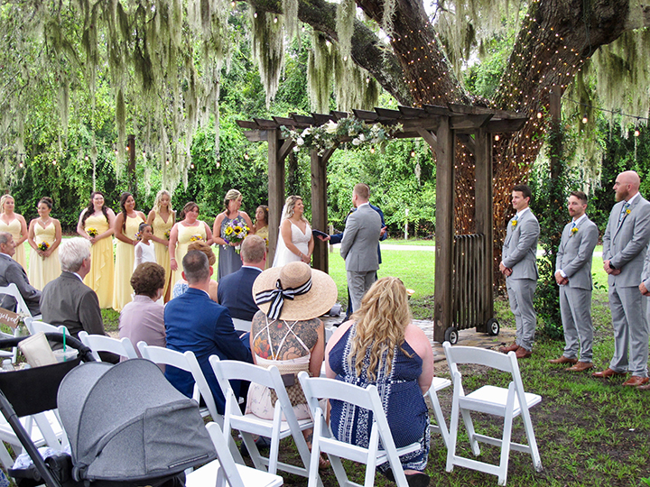 A couple getting married at Ever After Farms in Mims, FL with Orlando wedding DJ Chuck Johnson.