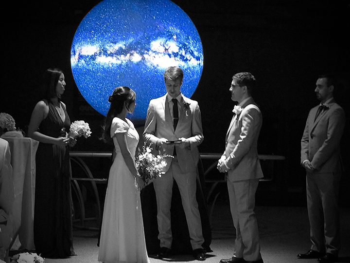 A couple at the their wedding ceremony at the Orlando Science Center.
